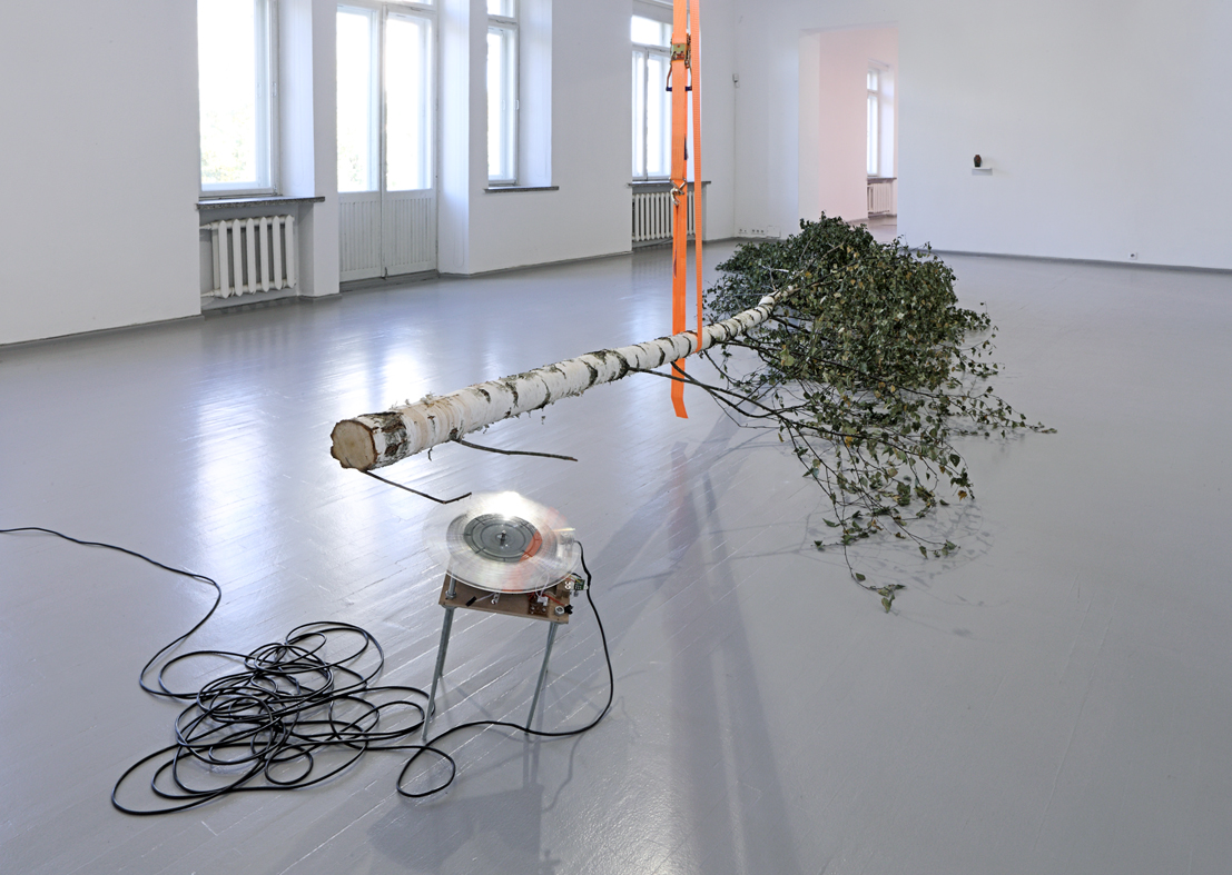 Savā nodabā, birch, vinyl LP, record player, needle, lashing belt. Installation view, Vartai gallery, 2016. Photo: Arturas Valiauga