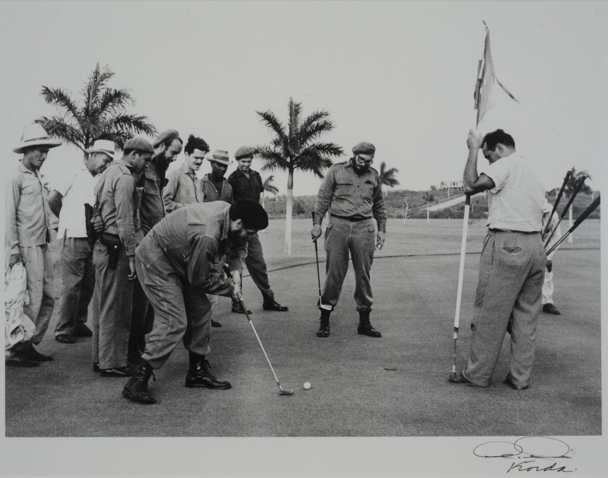 Che Guevara and Fidel Castro playing a game of golf