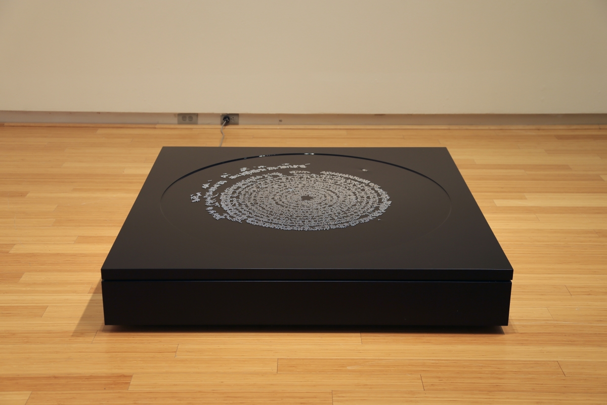 "Bearings, 2014, 55"" x 55"" x 9.5"", steel, aluminum, mineral oil, magnets"