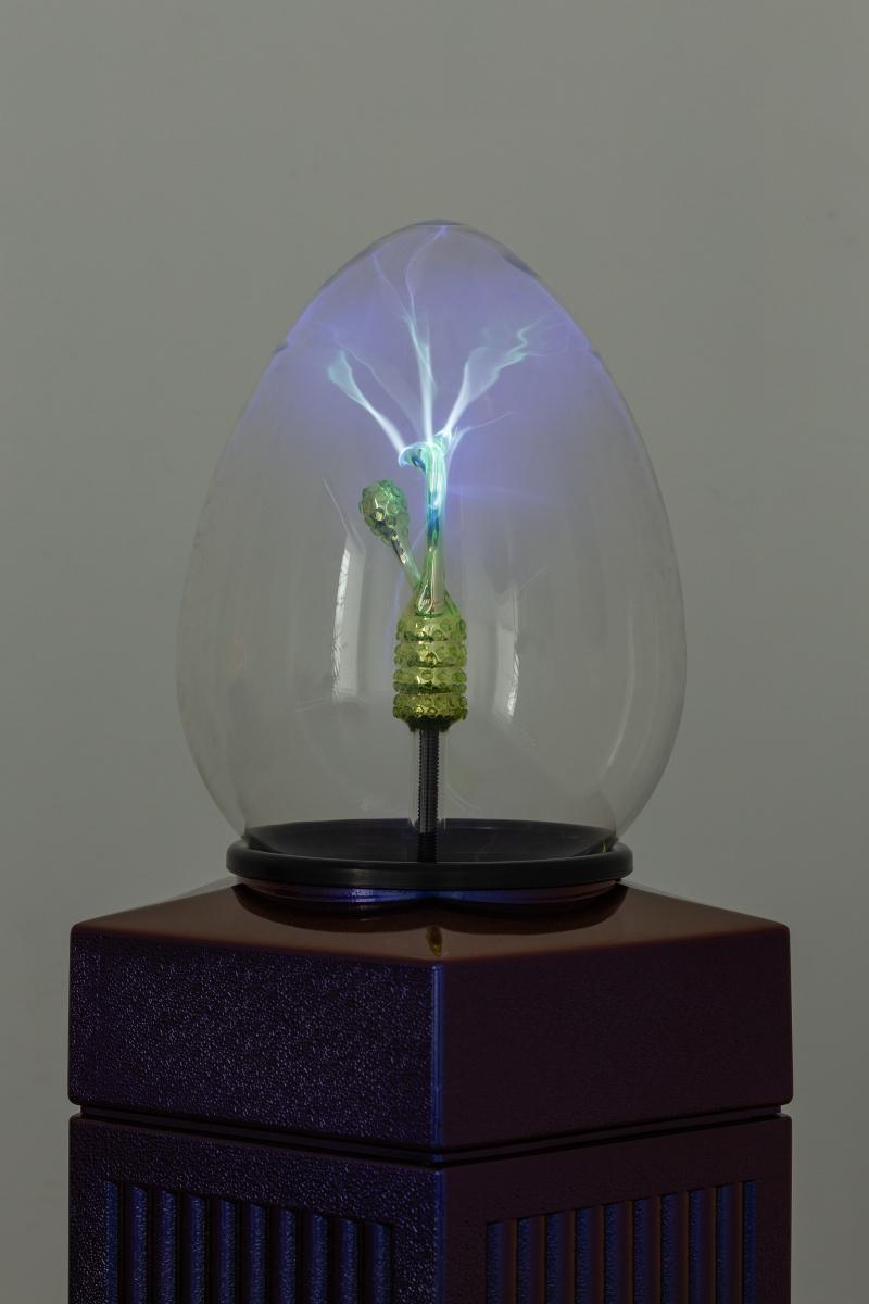 MAX HOOPER SCHNEIDER Plasm(0)void 7 (Uranium Germ), 2017 Borosilicate oviform, uranium glass embryo sculpture, noble gas mixture, high-voltage electrode, repurposed trash can 48.3 x 48.3 x 117 cm --- Plasm(0)void 11(Uranium Germ), 2017 Borosilicate oviform, uranium glass embryo sculpture, noble gas mixture, high-voltage electrode, repurposed trash can 48.3 x 48.3 x 117 cm. All works courtesy the artist and High Art, Paris