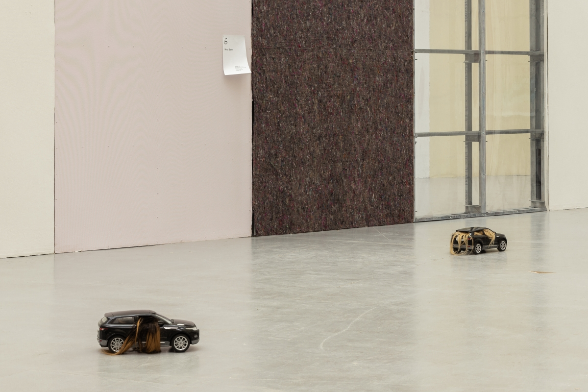 NINA BEIER Automobile, 2017 Two remote control vehicles (black Range Rover) and human hair 17 x 21 x 43 cm each Courtesy the artist and STANDARD (OSLO), Oslo