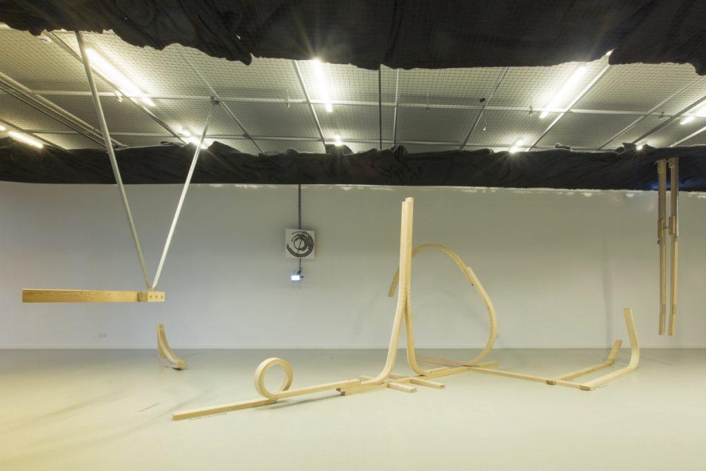 Anna Romanenko & Björn Kühn, Local Fittings, 2018.  Interactive installation. Bent ash gears, code, chronometer