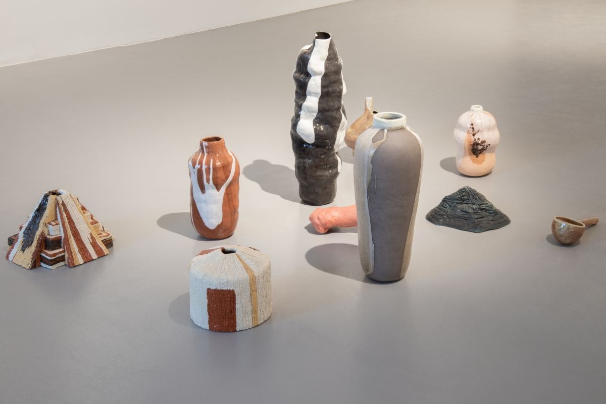 "Laura Põld ""A necklace, a ladle, a touching vase and other recollections in clay"". Installation: ceramics, earthenware, wood firing, found objects, 2016–2018. Photo: Madis Kats"