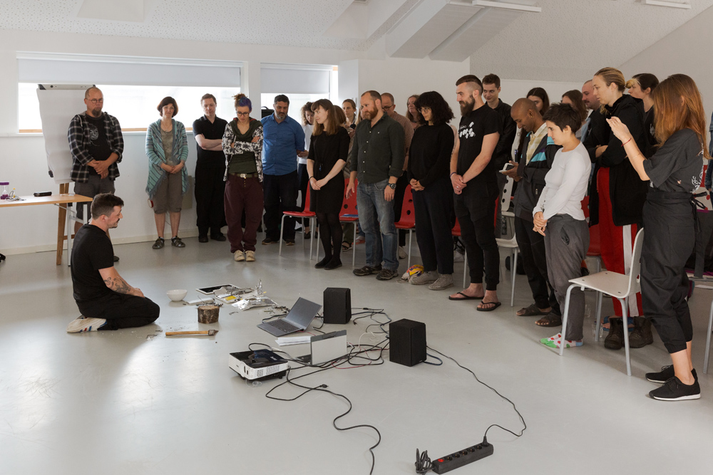 Performative talk Liturgy for Electronic Waste by Adrian Demleitner. Photo: Andrej Vasilenko