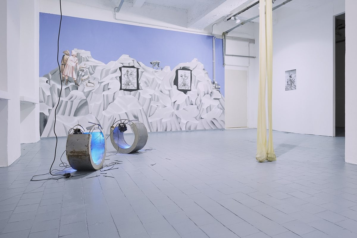 """Installation view of the exhibition, 'Extra-Planetary Commitment', lítost gallery, Prague. From left to right: Evita Vasiljeva, 'Hormones', (2017), metal, concrete, wood, cable ties, noise sensitive light, wires, each part 25 cm x 57 cm x 57 cm – Courtesy of the artist gallery; Botond Keresztesi, """"Miss Universe 1"""", black colour airbrush on paper, 29.7 cm x 42 cm – Courtesy of the artist; Botond Keresztesi, """"Miss Universe 2"""", black colour airbrush on paper, 29.7 cm x 42 cm – Courtesy of the artist; Evita Vasiljeva – 'There is no Grace in Shrinking', (2017), latex, pump, plastic tubes, various sizes – Courtesy of the artist; And Botond Keresztesi, """"The Audience"""", black colour airbrush on paper, 29.7 cm x 42 cm – Courtesy of the artist. Photograph by Lenka Glisníková. © lítost"""
